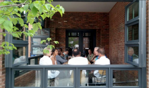 People enjoying open conversation at a Sustainable Small Business Leadership Lunch. (Image courtesy of Green Garage Detroit)